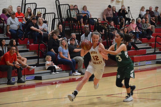 West Valley sophomore guard Madalynn Bassett attacks the basket against Le Grand senior Daleisy Garcia in the CIF Northern Regional Division V first round matchup on March 3, 2020.