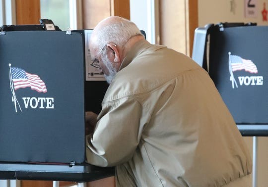William Nowdesha casts his ballot after work on Tuesday, March 3, 2020, at the Shasta Lake Community Center, where there was a line of voters for the presidential primary election.