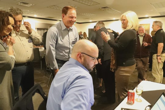 Leonard Moty smiles as his wife, Tracy, claps as early results show him in the lead for District 2 supervisor. Moty, the incumbent, was monitoring election returns with son Alex, foreground, on Tuesday night, March 3, 2020, at C.R. Gibbs American Grille in Redding.