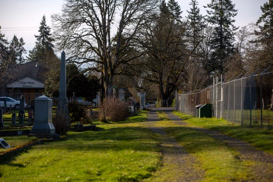 A path that winds through Pioneer Cemetery, pictured on Feb. 20, 2020, in Salem. The discussion of putting a gate on the north side of upper Pioneer Cemetery will be introduced to the city council by Vanessa Nordyke.