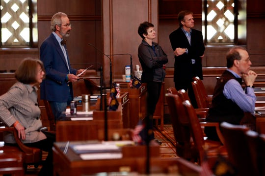 Senate Democrats listen to Senate President Peter Courtney, D-Salem, during a floor session in the Oregon State Capitol Building in Salem, Oregon, on Wednesday, March 4, 2020. Senate Republicans have missed every floor session since Feb. 24.