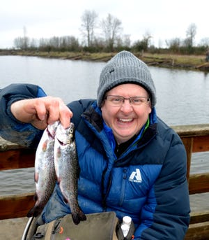 A chilled but happy Jonathan Berreth of Tigard scored a pair of trout during the first day the access-road opened on March 1 at St. Louis Ponds west of Gervais.