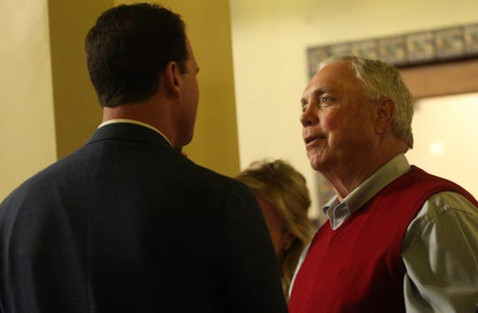 Drew Darby, right, speaks with August Pfluger, left, at a watch party at the Cactus Hotel as election results roll in on Tuesday, March 3, 2020.