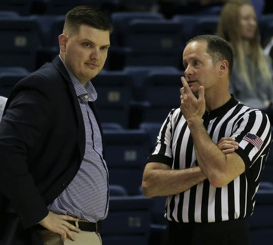 Angelo State University head coach Nate Harris questions an official during a game against Midwestern State in the first round of the Lone Star Conference Women's Basketball Tournament at the Junell Center on Tuesday, March 3, 2020. The first-year head coach guided the Belles to an 81-70 win.