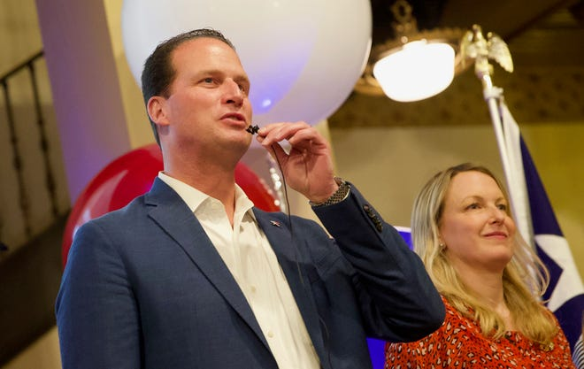 August Pfluger, center, speaks to supporters at an election night watch party at the Cactus Hotel with his wife Camille, right, as results come in Tuesday, March 3, 2020.
