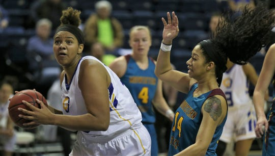 Angelo State University's De'Anira Moore pulls down a rebound during a win against Midwestern State in the first round of the Lone Star Conference Women's Basketball Tournament at the Junell Center on Tuesday, March 3, 2020.