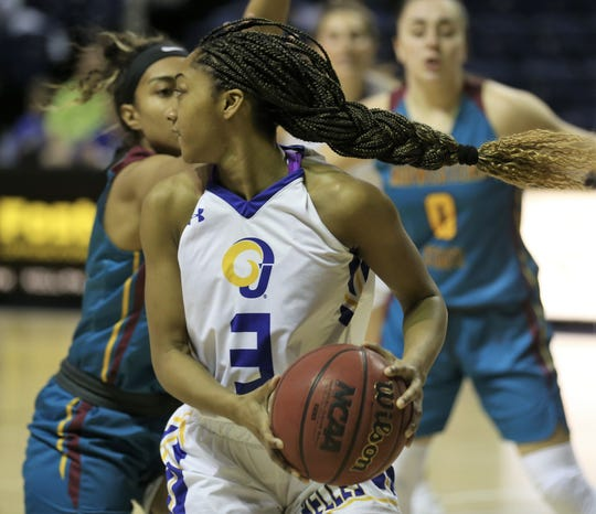Angelo State University's Asia Davis gets ready to pass during a first-round game against Midwestern State at the Junell Center on Tuesday, March 3, 2020.