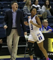 Angelo State University head coach Nate Harris gets fired up as Asia Davis keeps her eyes on the ball earlier in the season. The Belles were scheduled to play in the South Central Regional in Lubbock beginning on Friday, but the tournament was canceled due to coronavirus (COVID-19) concerns.