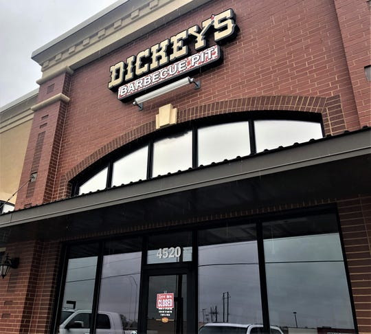 """Dickey's Barbecue Pit at 4520 Sherwood Way on March 4, 2020, with a """"Sorry, We're Closed"""" sign."""
