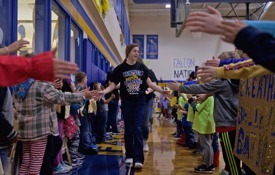Members of the Veribest girls basketball team high five students during a send off event Wednesday, March 4, 2020 as they head to the state tournament in San Antonio on Thursday.