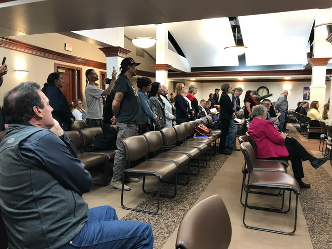 Lt. Gov. Larry Rhoden listens to testimony as audience members stand in opposition to Gov. Kristi Noem's riot boosting bill at the Capitol on Tuesday night.