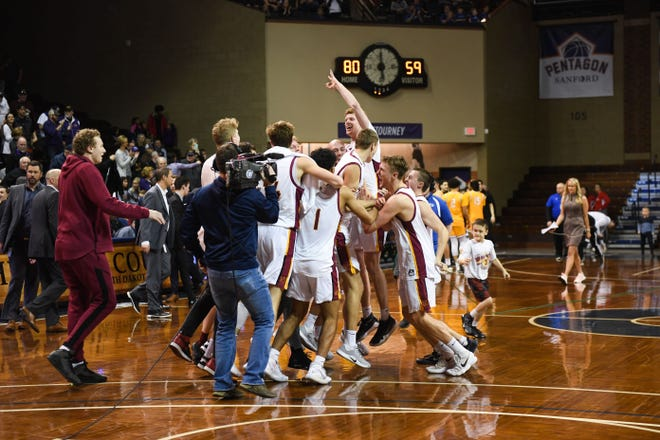 Northern State University celebrates winning the Northern Sun Intercollegiate Conference championship game on Tuesday, March 3, at the Sanford Pentagon in Sioux Falls.