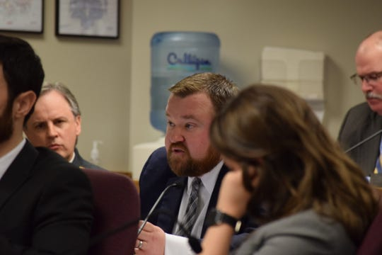 Rep. Jered Taylor, R-Nixa, center, speaks at an oversight committee hearing regarding the rollout of the state's medical marijuana program on March 4, 2020.