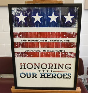 Paintings honoring the soldiers killed in a Black Hawk helicopter crash outside of St. Cloud in December were presented by three inmates at the St. Cloud prison on Wednesday, March 4, 2020.