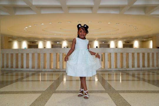 "Kaia Rolle, 6, stands in her ""princess pose"" in the third-floor Capitol rotunda Wednesday, March 4, 2020. Rolle was restrained, arrested and taken to a juvenile facility after having a temper tantrum at her Orange County elementary school in September 2019. This week, her family traveled four hours to the Capitol to lobby for ""The Kaia Rolle Act"" which would require a procedure for law enforcement officers when interacting with children younger than 10 years of age regarding criminal matters."