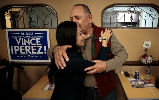 Claudia Ordaz Perez hugs her uncle Juan Garcia shortly after arriving at her election night watch party Tuesday.
