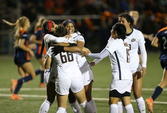UTEP players celebrate a game-wining goal against UTSA last season at University Field