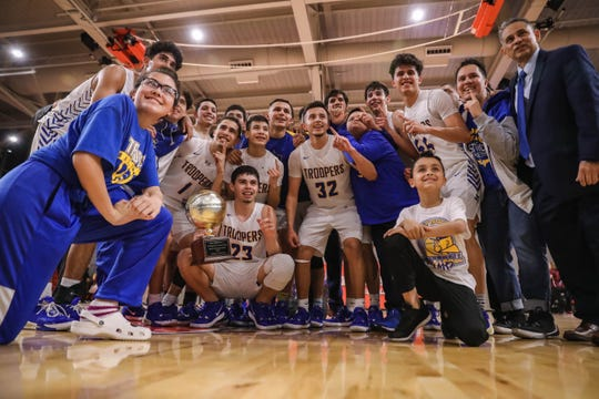 Eastwood High School celebrates a win against Andress High School during the 5A Regional Quarter Final at Bel Air High School in El Paso on Tuesday, March 3, 2020.