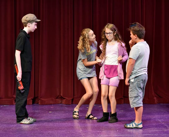 Children in the Let's Make a Play summer camp at the Greenville Theatre rehearse their lines.