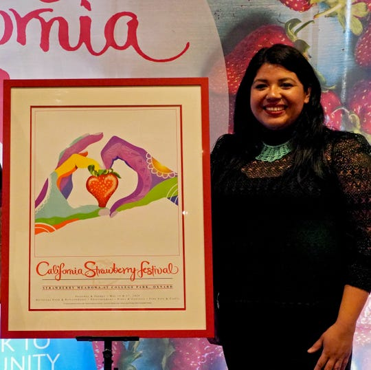 """Artist Kimberly Duran poses by her artwork """"Love Strawberries,"""" which was selected as the winner of the California Strawberry Festival poster contest."""