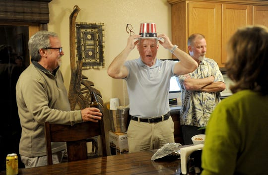 Oxnard Mayor Tim Flynn, center, who is running in the Fifth District race for supervisor, celebrates early results Tuesday night with Sean Murphy, left, and Duane Mottar at his Flynn's father's house. Flynn will face Oxnard Councilwoman Carmen Ramirez in the November runoff.