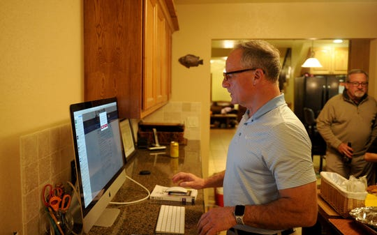 Oxnard Mayor Tim Flynn, who is running in the Fifth District race for supervisor, looks at his computer Tuesday night at his father John Flynn's house.
