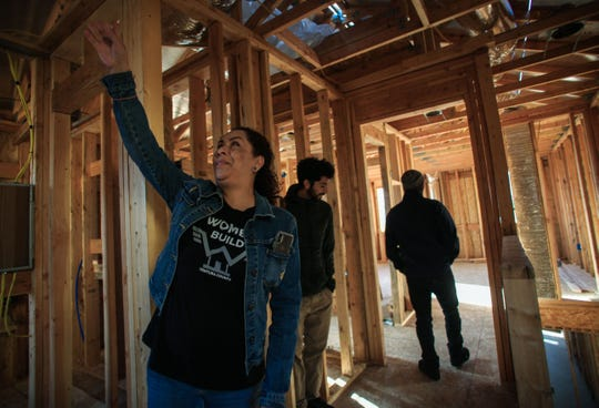Laura Lembo shows areas she helped build at her new Habitat for Humanity home in Camarillo. Two families walked through their new homes during construction.