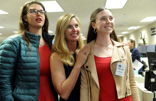 Supervisor Kelly Long, center, with daughters Madelynn Long, 16, left, and Morgan Long, 13, watch the returns come in Tuesday for the Third District race for supervisor at the Ventura County elections office in Ventura.
