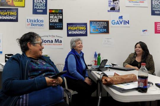 Oxnard Councilwoman Carmen Ramirez, center, talks with supporters Laura Gallardo and Ronni Miranda Tuesday at her campaign office at the Greater Oxnard Organization of Democrats headquarters.