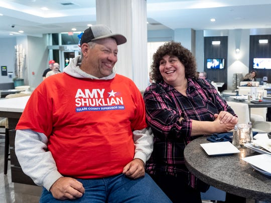 Ralph McDonald, left, sits with Supervisor Amy Shuklian as supporters wait on election results at the Marriott on Tuesday, March 3, 2020.