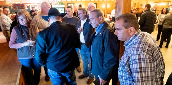 Larry Micari, right, waits on election results with supporters at Whitney's Wild Oak Ranch on Tuesday, March 3, 2020.
