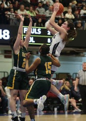 Putnam Valley's Eva Dechent (21) goes up for a shot in front of Hastings Ali Manly (2) during the girls Class B semifinal at the Westchester County Center in White Plains March 3, 2020. Putnam Valley won the game 69-46.