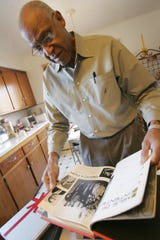 Clarence Branch looks through old year books from Tappan Zee high school at his Piermont home Feb. 7, 2007.