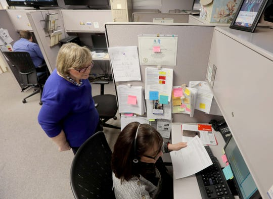 Marjorie Cubisino, a team leader at the United Way of Westchester Putnam's 2-1-1 call center in White Plains, works with Elyse Lento, a community resource specialist March 4, 2020. The United Way is partnering with Westchester County in answering questions residents have about the coronovirus.