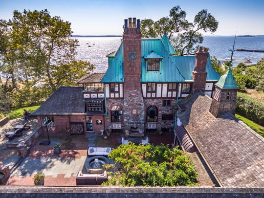 """The exterior of a home on Larchmont's waterfront that was once owned by Jean Kerr, who wrote """"Please Don't Eat The Daisies."""" It is on the market."""