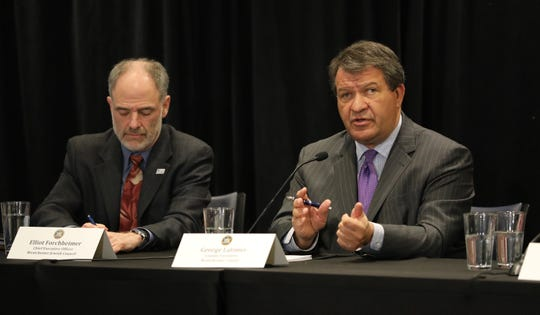 George Latimer, the Westchester County Executive, right, delivers remarks as New York Governor Andrew Cuomo discusses the new cases of the Coronavirus in New Rochelle, during a press briefing at the New York Power Authority in White Plains, March 4, 2020. At left is Elliot Forchheimer, CEO, The Westchester Jewish Council.