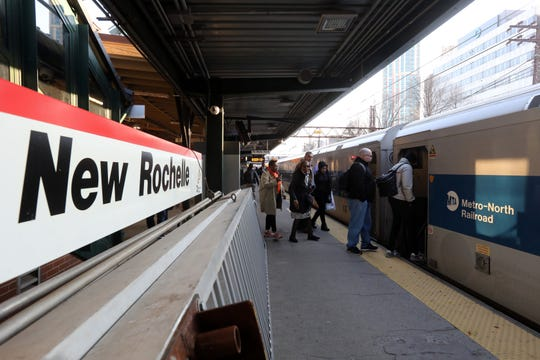 Commuters board a morning Metro-North train heading to Grand Central Terminal in New Rochelle March 4, 2020. It was announced the day before that a New Rochelle man who commuted on Metro-North was tested positive for coronavirus.