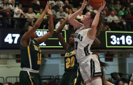 Putnam Valley's Kelli Venezia (13) puts up a shot in front of Hastings Violet Bowen-Rink (15) during the girls Class B semifinal at the Westchester County Center in White Plains March 3, 2020. Putnam Valley won the game 69-46.