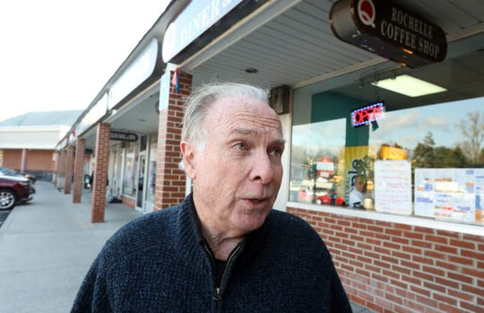 Ed Barone of New Rochelle reacts to the news of a second person, a New Rochelle resident, testing positive for coronavirus, at Quaker Ridge Shopping Center in New Rochelle March 4, 2020.