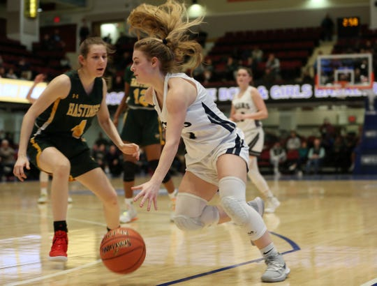 Putnam Valley's Amanda Orlando (1) drives to the basket in front of Hastings Lindsay Drozd (4) during the girls Class B semifinal at the Westchester County Center in White Plains March 3, 2020. Putnam Valley won the game 69-46.