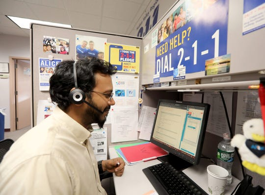Rommel Lashley takes a call at the United Way of Westchester Putnam's 2-1-1 call center in White Plains March 4, 2020. The United Way is partnering with Westchester County in answering questions residents have about the coronovirus.