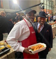 "Clint ""Chef Bones"" Harris (left) with weatherman Al Roker in Rockefeller Center in New York during an appearance on NBC's ""Today"" in November."