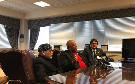 Muslim Center of Wilmington Imams Rudolph Ali(left) and Muhammad Salaam(middle) sit with New Castle County Executive Matt Meyer at a press conference.
