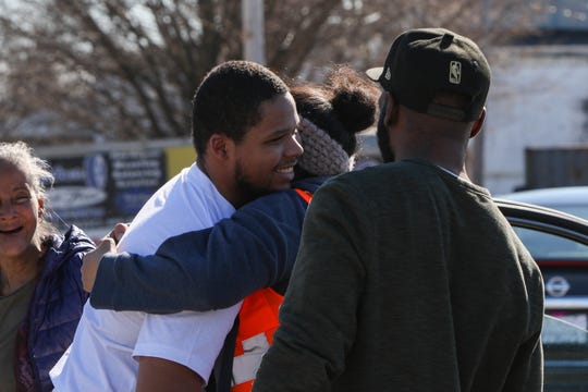 19-year-old Yahim Harris hugs family after being released from Howard R. Young Correctional Institution on Wednesday, March 4. The Wilmington teenager was accused of carjacking and then shot by the police during his arrest.