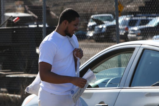 19-year-old Yahim Harris gets ready to leave Howard R. Young Correctional Institution, where he was released on Wednesday, March 4. The Wilmington teenager was accused of carjacking and then shot by the police during his arrest.