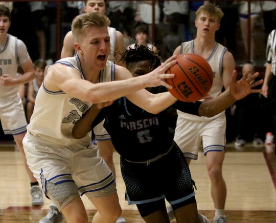 Decatur's Carson Tibbels, left, grabs the rebound by Hirschi's Ernest Young Tuesday, March 3, 2020, in Bowie.