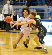 Rider's Kellar Owens is fouled by Amarillo High's Keaton Parker in a Region I-5A quarterfinals matchup in Childress on Tuesday, March 3, 2020.