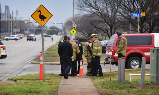 Wichita Falls firefighters check underground utility manholes after gasoline was detected leaking from a convenience store at Kemp Boulevard and Call Field Road early Wednesday morning.