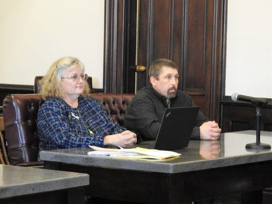 Assistant Public Defender Marie Seiber with client Branden A. Russell of West Lafayette in Coshocton County Common Pleas Court. Russell received 11 months in prison for possession of LSD, a fifth-degree felony.