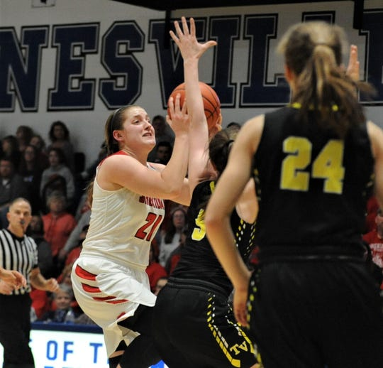 Sheridan's Kendyl Mick puts up a shot over Tri-Valley's Janie McLoughlin (5) in the Division II regional semifinal on Tuesday at Zanesville. The Scotties won 50-48.